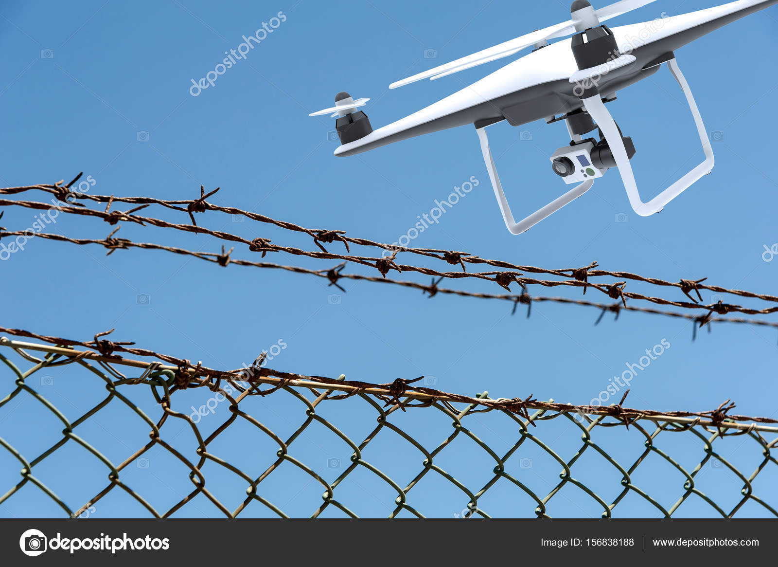 Drone with digital camera flying over a barbed wire fence — Stock ...