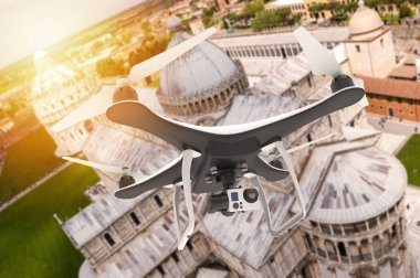 Drone with digital camera flying over an italian city