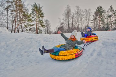 Happy children on a winter sleigh ride