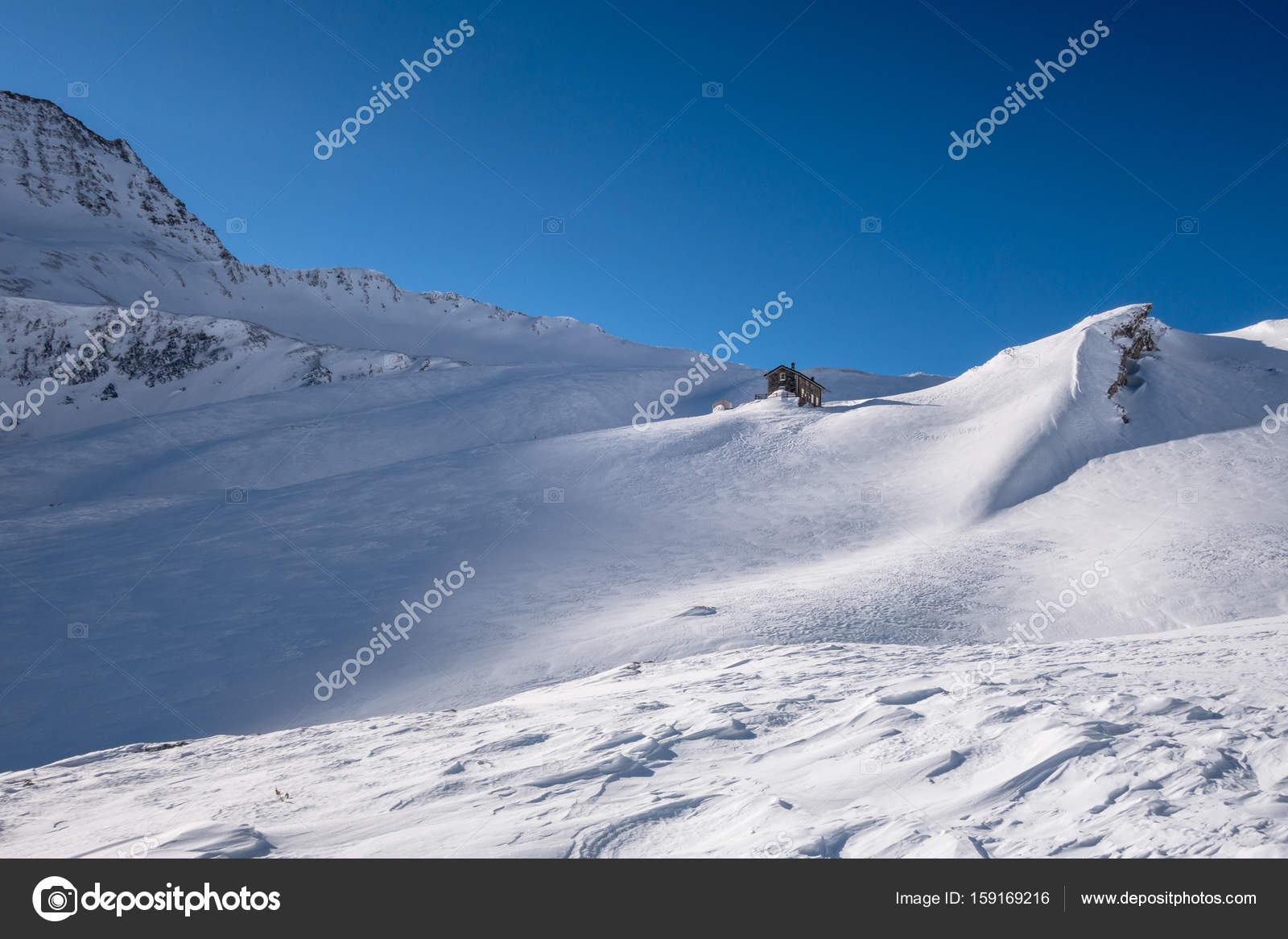 Alpine Refuge Below Mountain Ridge In Winter On Windswept Untracked Snow Stock P O