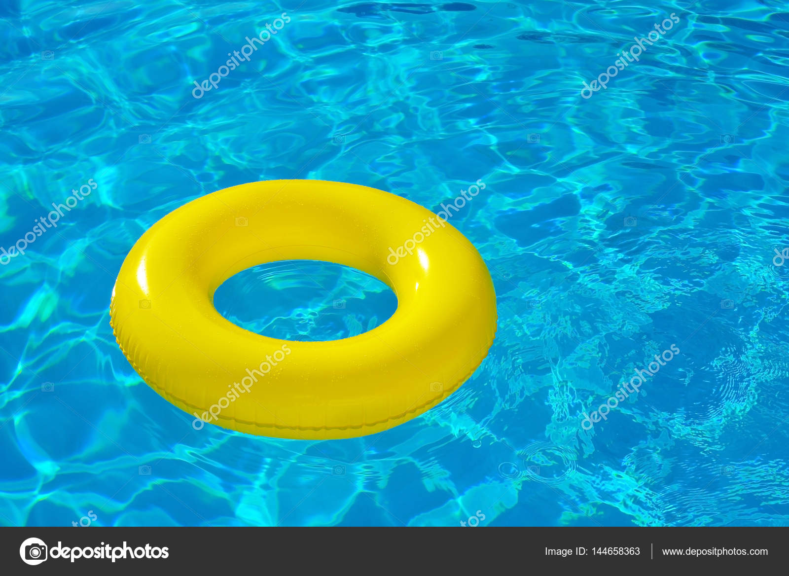 Inflatable tube floating in swimming pool — Stock Photo ...
