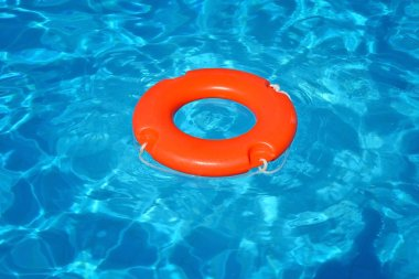 Colorful lifebuoy floating in swimming pool, summer vacation concept stock vector