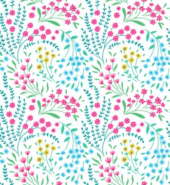 Cute seamless pattern in small flowers