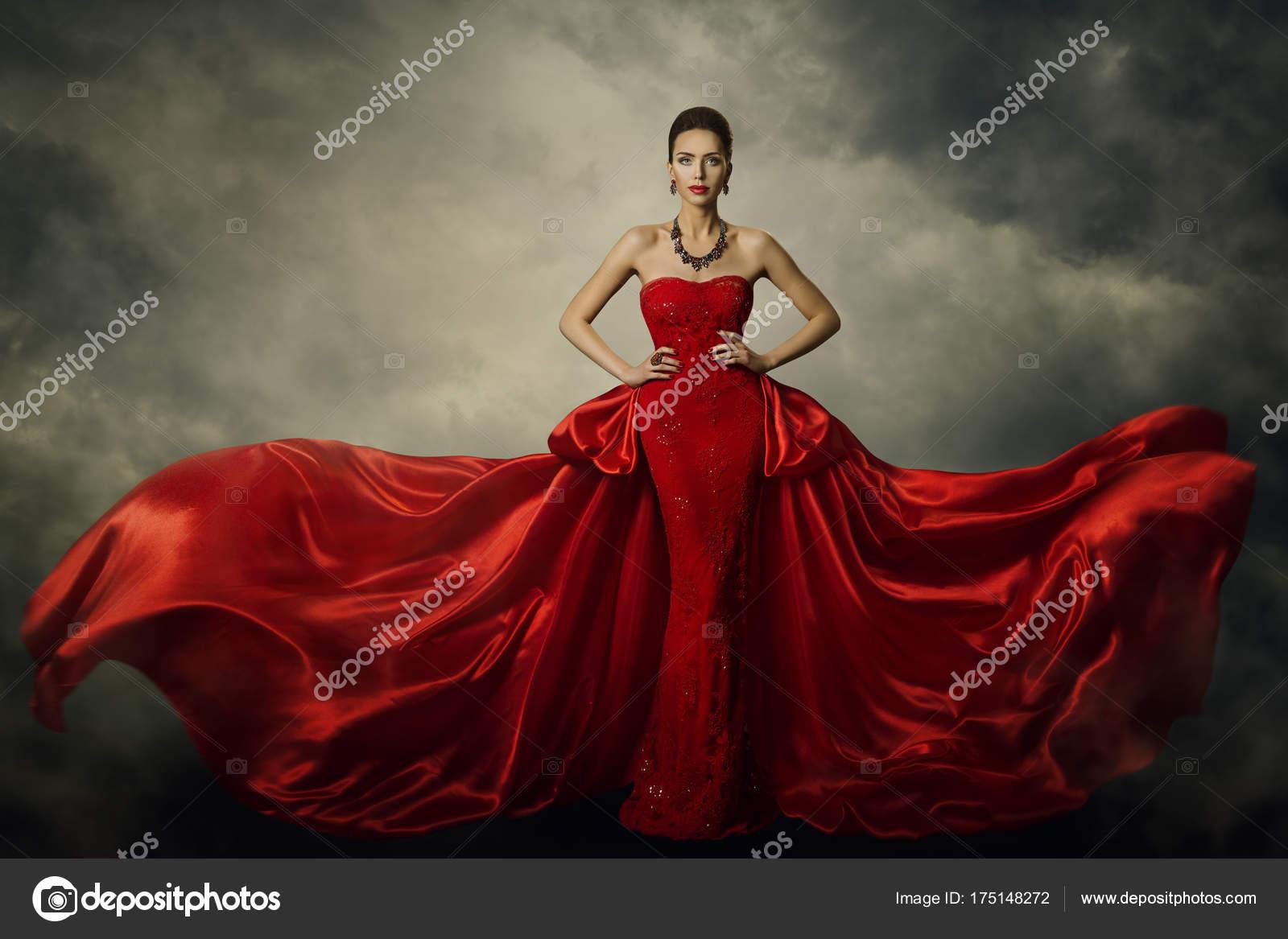 Modell Art Kleid Mode, elegante Frau, die in roten Retro-Kleid ...