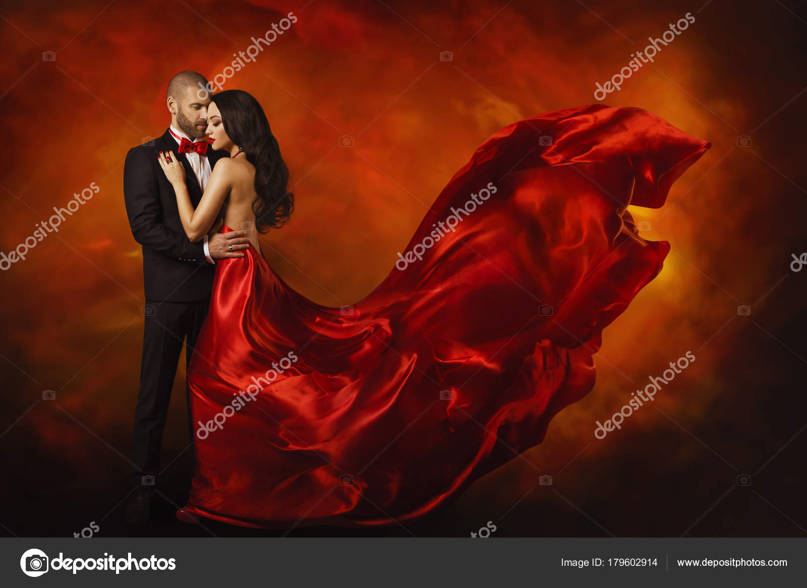 a0a605f495c2 Elegant Couple, Dancing Woman in Red Dress Fluttering Flying on wind and  Man in Black
