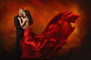 Elegant Couple, Dancing Woman in Red Dress Fluttering Flying on wind and Man in Black Suit, Love Portrait