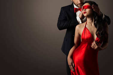 Couple Love Kiss, Sexy Blindfolded Woman Dancing in Red Dress and Elegant Man