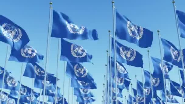 Waving Flags of United Nations against blue sky
