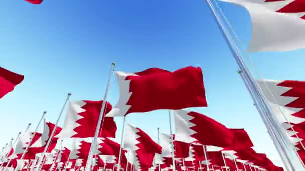 National flags of the Kingdom of Bahrain waving in the wind against blue sky. Three dimensional rendering 3D animation.