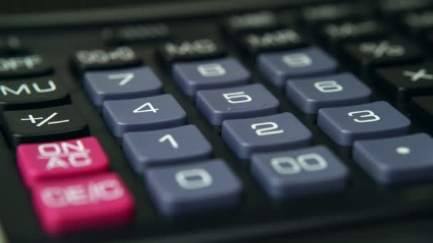 Counting on the calculator with pencil close up 4K.  Budget, finances.
