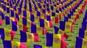 Many flags of Andorra waving in the windin green field. Three dimensional rendering 3D illustration.