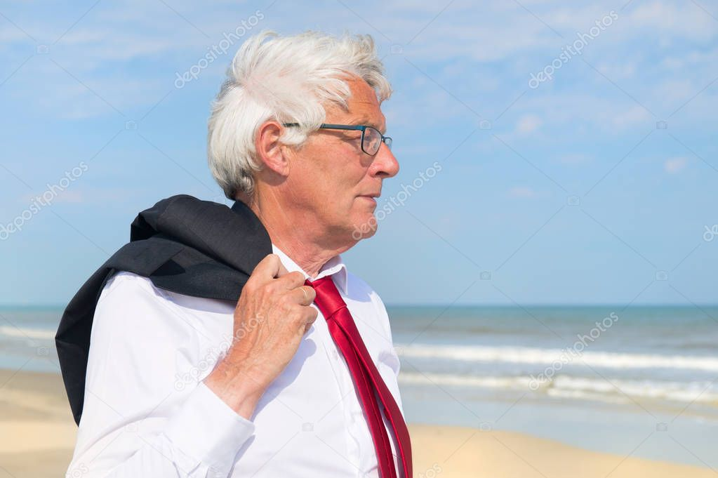 Business man at the beach