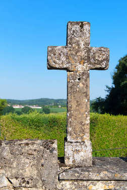 Old stone cross in landscape