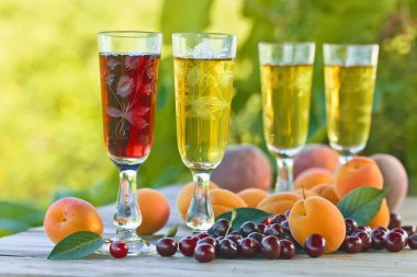 Glasses of sweet white and fruits on wooden table