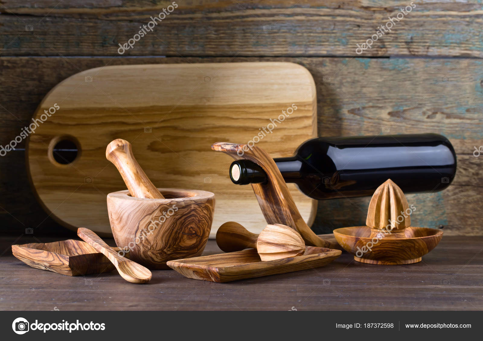 Set of wooden kitchen utensils made from olive wood photo by igorr1