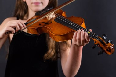 Close up of professional violin in hands of little violinist playing it