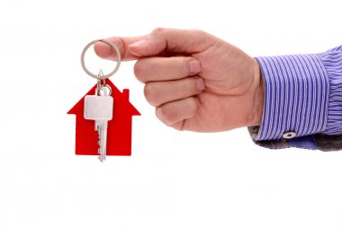 house key in hand of real estate agent isolated over white background