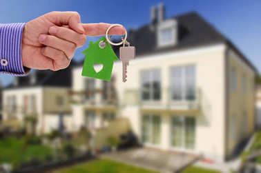 real estate agent offers a key for your new residential home
