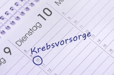 calendar marked with an appointment for cancer screening, in german language: Krebsvorsorge
