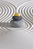 Japanese Zen garden with stacked stones in textured sand