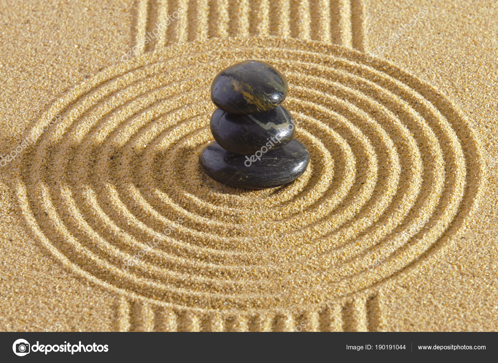 Japanese Zen garden of tranquility with stone in textured sand ...