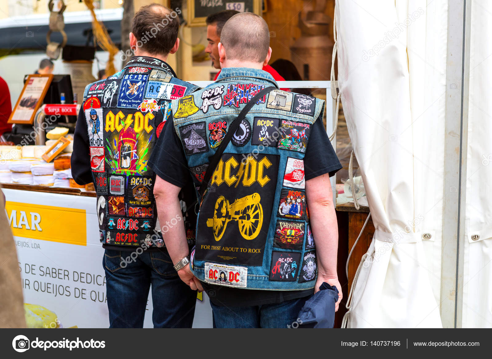 Lisbon, Portugal - 05 06 2016: Two fans of band AC/DC wearing ja ...