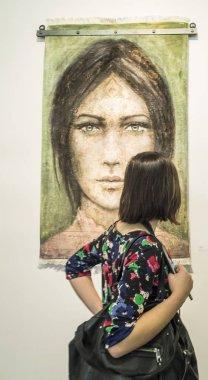 Visitor looking at artwork