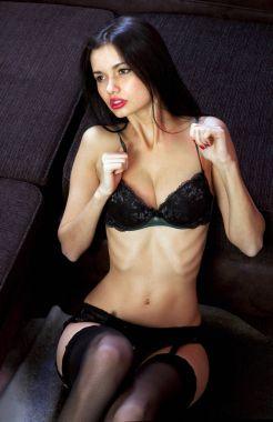 voluptuous mistress in black underwear