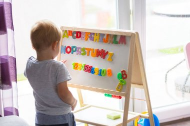 Little boy learning alphabet