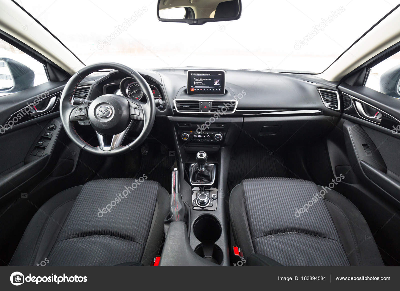 poland february 11 2018 black interior of mazda 3 captured in winter time mazda 3 is a popular compact car manufactured in japan by the mazda motor