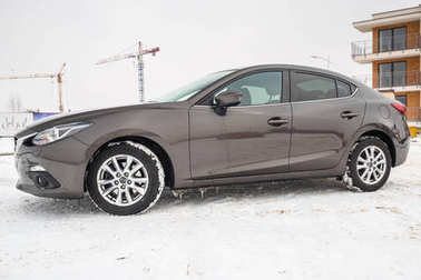 POLAND - FEBRUARY 11, 2018: Compact car Mazda 3 captured in winter time. Mazda 3 is a popular compact car manufactured in Japan by the Mazda Motor Corporation.