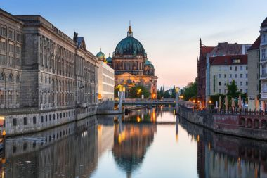 Berlin, Germany - June 15, 2017: Berlin Cathedral (Berliner Dom) and TV Tower at sunrise, Germany. Berlin is the capital and the largest city of Germany.