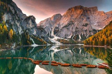 Lago di Braies lake and Seekofel peak at sunrise, Dolomites. Italy stock vector