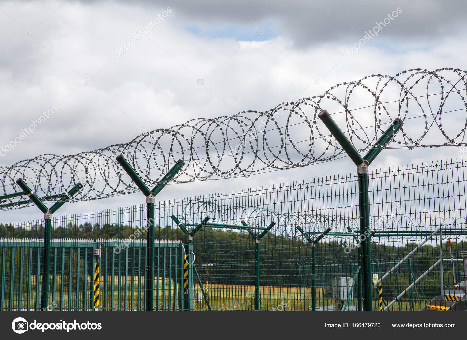 Security fence with a barbed wire. Fence with a barbed wire. — Stock ...