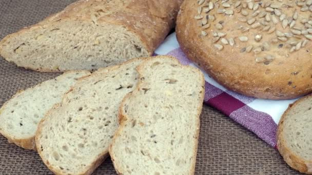 Fresh bread on table. Baked dark bread and sliced bread.