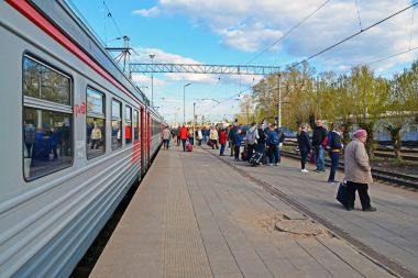 Tver, Russia - may 07.2017. People go to train at the station