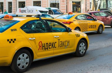 Moscow, Russia - July 24. 2017. Taxi company Yandex and Uber go on street Sretenka