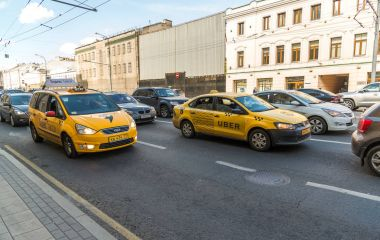 Moscow, Russia - July 24. 2017. Taxi company Yandex and Uber go on prospekt Mira street