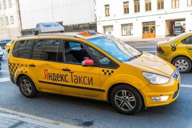 Moscow, Russia - July 24. 2017. Taxi company Yandex go on prospekt Mira street