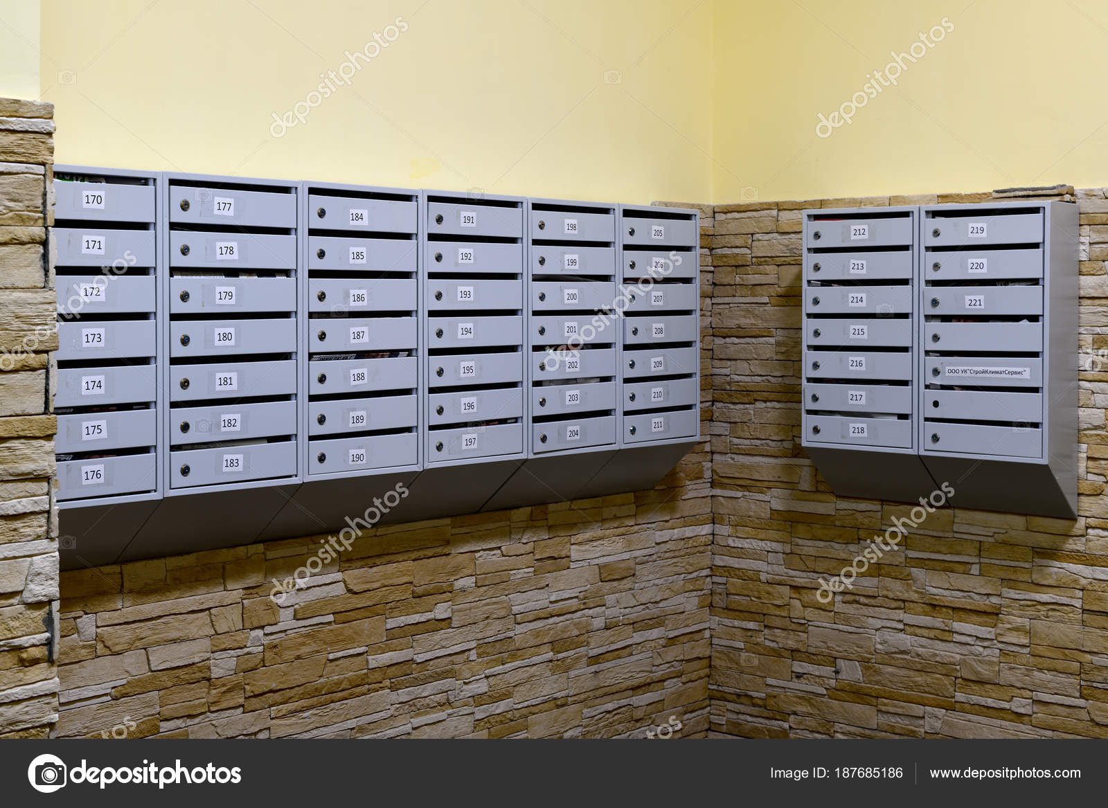 Gray mailboxes in corridor of the apartment building — Stock ...
