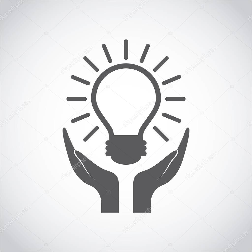 hands and bulb light icon