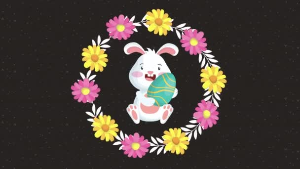 happy easter animated card with rabbit and egg painted in floral frame