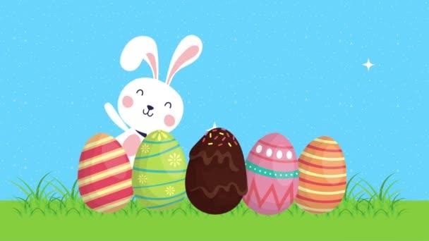 boldog húsvéti animációs kártya nyúl és tojás festett a táborban