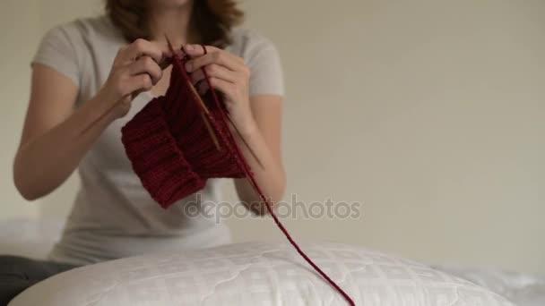 Woman knitting a hat