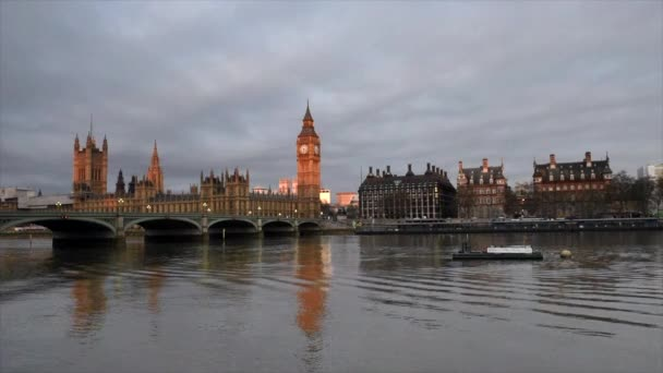 London.The Big Ben and Westminster Bridge at sunset, England.