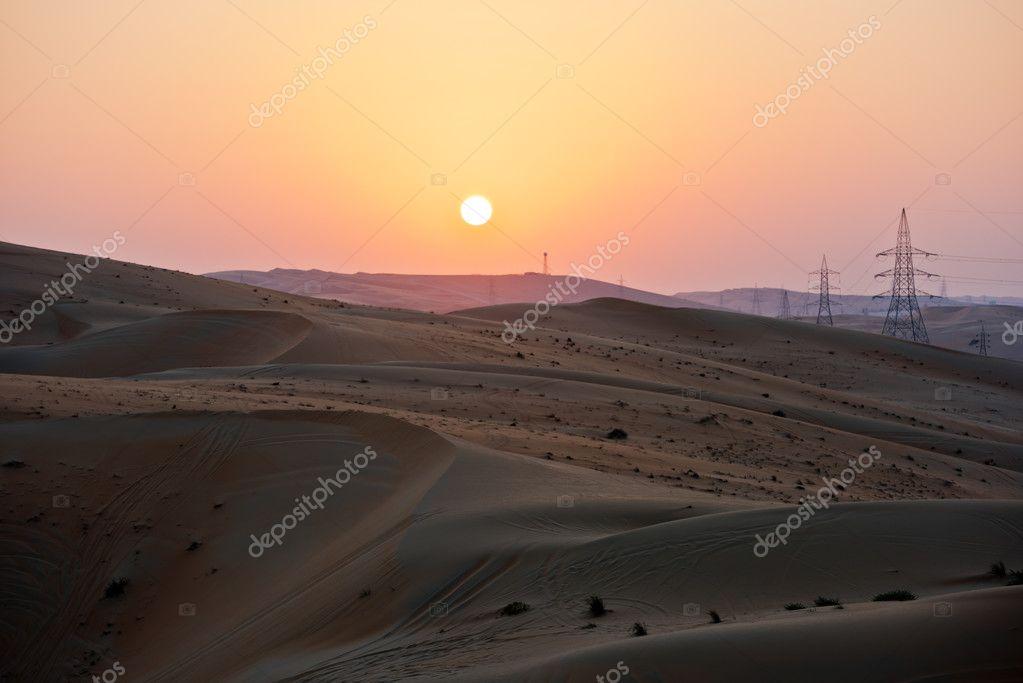 Power line in dunes in Liwa