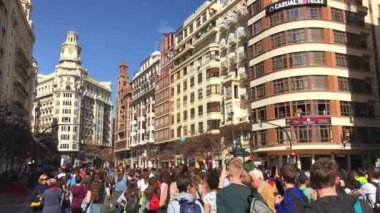 People crowd after celebrating the Mascleta during Fallas Holiday at Ajuntament square in Valencia Spain