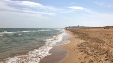 Video of a long Sand Beach with the sea surf. Alicante, Spain