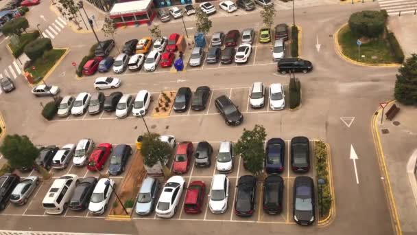 Video of a large street parking full of cars near a shopping mall in Valencia, Spain