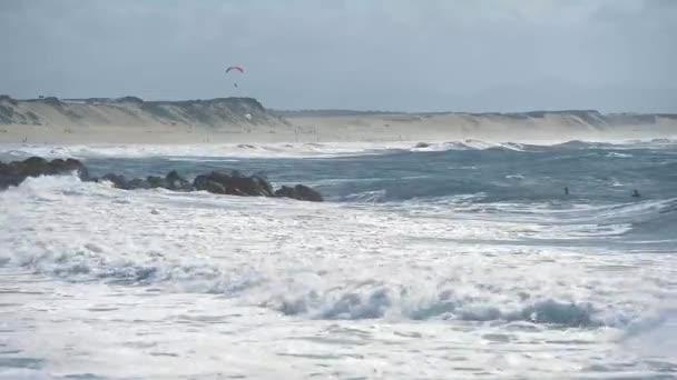 Silhouettes of surfers on the Atlantic ocean waves nearCapbreton, France